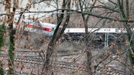 injuring: BRONX, NEW YORK - DECEMBER 1: A Metro North train derails killing and injuring people near Spuyten Duyvil Station.  Taken December 1, 2013, in the Bronx,  New York. Editorial