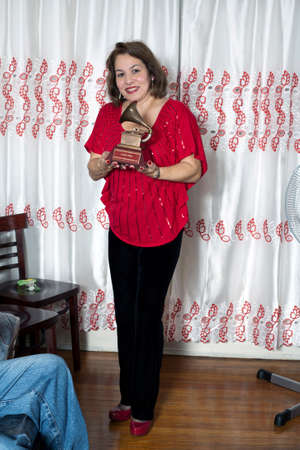 Yomo Toro s niece Elizabeth holds Latin Grammy in honor of cuatro player Yomo Toro who passed away before he could accept it  Taken December 23, 2012  Bronx, NY