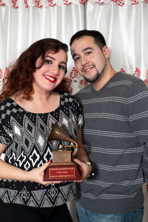 Yomo Toro s niece Christina and her boyfriend hold  Latin Grammy to remember  international cuatro player Yomo Toro who was awarded the Grammy but passed away before he could accept it  Taken December 23, 2012 in the Bronx,