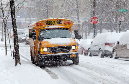 BRONX, NEW YORK - JANUARY 21  School bus during a 6 to 10 inch snow storm with teen temperatures along Ogden avenue and 162nd street   Taken January  21,  2014 in the Bronx,  New York