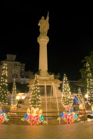 colonizer: Colon Plaza or Columbus Plaza with Christmas lights located at the entrance to Old San Juan