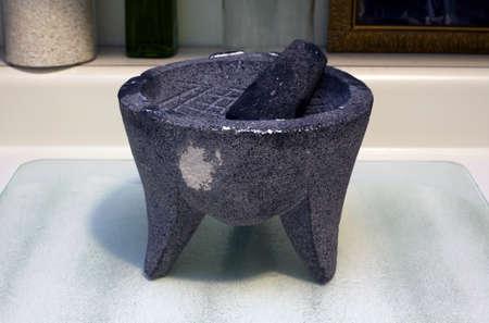 A primitive Mexican grinding stone. Banco de Imagens