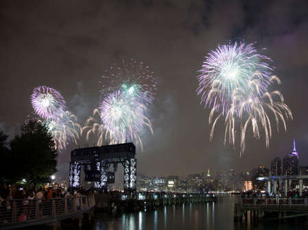 macys: QUEENS, NEW YORK - JULY 4: Macys independence day firework celebration in NYC as viewed from Gantry Plaza State Park in Long Island City.   Taken July 4, 2015 in Queens, NY.