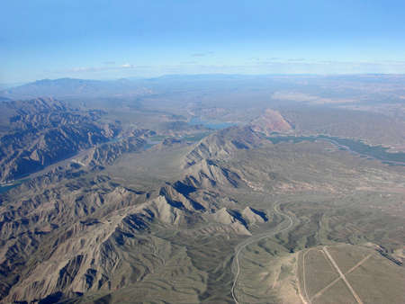 mead: Aerial view of Lake Mead which is located  in the state of Nevada. Formed by water impounded by the Hoover Dam in the USA. Stock Photo