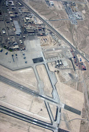 landing strip: NELLIS AIR FORCE BASE, NEVADA - MARCH 30: Aerial view of Nellis AFB with section of landing strip in view.   Taken March 30, 2015 in Nellis AFB, Nevada.