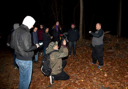 HUNTINGTON, NEW YORK, USA - NOVEMBER 14,  2015: Randy talks about the history of Mount Misery road during a meetup by the Brooklyn Paranormal Society of NY  as they investigate Mount Misery Road in Long Island. Known for tales and legends of paranormal si 報道画像