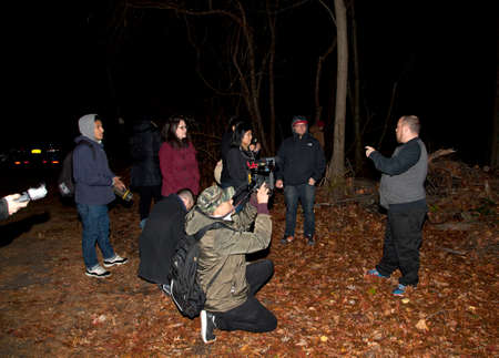 paranormal: HUNTINGTON, NEW YORK, USA - NOVEMBER 14,  2015: Randy talks about the history of Mount Misery road during a meetup by the Brooklyn Paranormal Society of NY  as they investigate Mount Misery Road in Long Island. Known for tales and legends of paranormal si Editorial