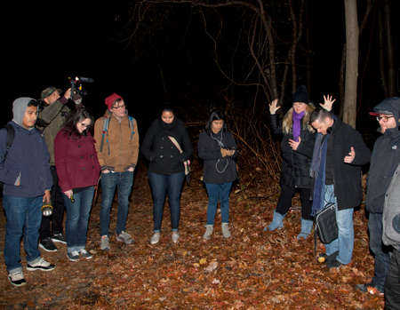 paranormal: HUNTINGTON, NEW YORK, USA - NOVEMBER 14,  2015: Stacy the blonde leads members of the Brooklyn Paranormal Society of New York in prayer before their investigation of Mount Misery Road in Long Island. Known for tales and legends of paranormal sightings.