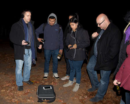paranormal: HUNTINGTON, NEW YORK, USA - NOVEMBER 14,  2015: Members of the Brooklyn Paranormal Society of NY during their investigation of Mount Misery Road in Long Island. Known for tales and legends of paranormal sightings.
