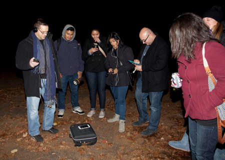misery: HUNTINGTON, NEW YORK, USA - NOVEMBER 14,  2015: Members of the Brooklyn Paranormal Society of NY during their investigation of Mount Misery Road in Long Island. Known for tales and legends of paranormal sightings.