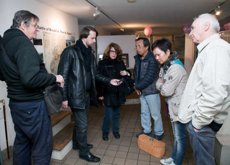 paranormal: BROOKLYN, NEW YORK, USA - NOVEMBER 22: Raymond Sawyers center takes readings while  members of the borough paranormal meetup group of NY investigate the Old Stone House.  Taken November 22, 2015 in NY. Editorial