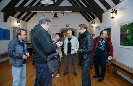 BROOKLYN, NEW YORK, USA - NOVEMBER 22: Members of the borough paranormal meetup group of NY take readings while they investigate the Old Stone House.  Taken November 22, 2015 in NY. 報道画像