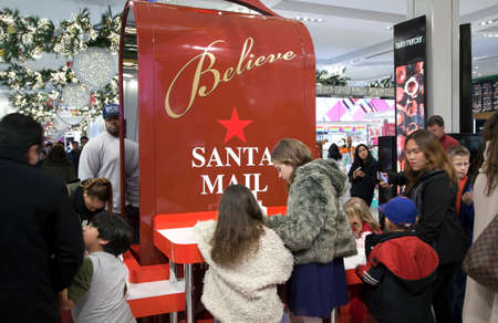 macys: NEW YORK, NEW YORK, USA - DECEMBER 10: Children write letters to Santa inside Macys department store in Herald Square and 34th street.  Taken December 10, 2015 in NY.