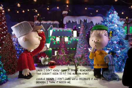 macys: NEW YORK, NEW YORK, USA - DECEMBER 10: A Macys window display for Christmas showing Charlie Brown and Linus picking a Christmas tree.  Taken December 10, 2015 in NY.