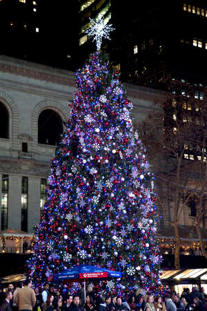 bryant: NEW YORK, NEW YORK, USA - DECEMBER 10: People in Bryant Park with Christmas Tree in background.  Taken December 10, 2015 in NY.
