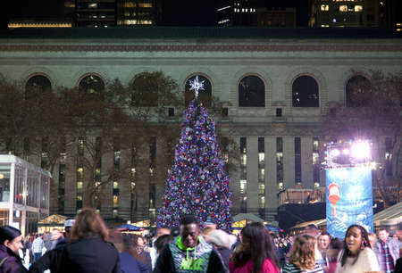 bryant: NEW YORK, NEW YORK, USA - DECEMBER 10: People skate in Bryant Park with Christmas Tree in background.  Taken December 10, 2015 in NY.