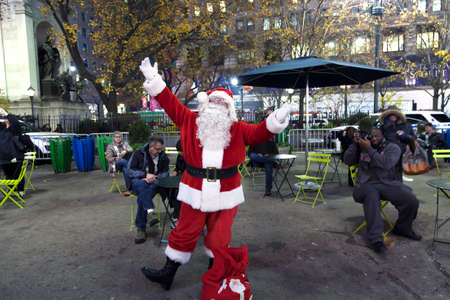 saint nick: NEW YORK, NEW YORK, USA - DECEMBER 10: Santa Claus poses in front of Macys department store in Herald Square and 34th street.  Taken December 10, 2015 in NY.