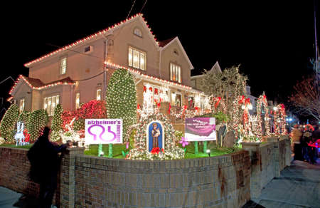 83rd: BROOKLYN, NEW YORK, USA - DECEMBER 19: A Christmas lighted house between 11th and 12th avenue and 83rd street, owned by Vincent Privitell with money being raised for Alzheimers awareness,  between 11th and 12th avenue and 83rd street. Taken December 19,  Editorial
