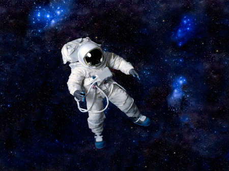 zero gravity: Astronaut wearing pressure suit against a space background.