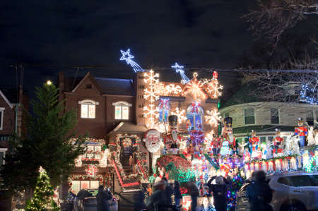 saint nick: BROOKLYN, NEW YORK, USA - DECEMBER 19: A house in Dyker Heights with Christmas lights  between 11th and 12th avenue and 83rd street.  Taken December 19, 2015 in New York.