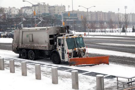 sanitation: BRONX, NEW YORK, USA - FEBRUARY 19: Sanitation truck performs street snow cleaning.  Taken February 19, 2015 in the Bronx,  New York.