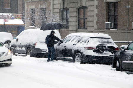 bronx county: BRONX, NEW YORK, USA - MARCH 3: Man cleans his car during snow storm.  Taken March 3, 2015 in the Bronx,  New York.
