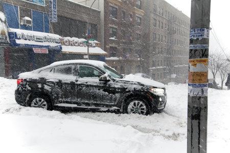 bronx county: BRONX, NEW YORK - JANUARY 23: Auto stuck on Anderson Avenue during snow storm Jonas.  Taken January 23, 2016, in the Bronx,  New York.