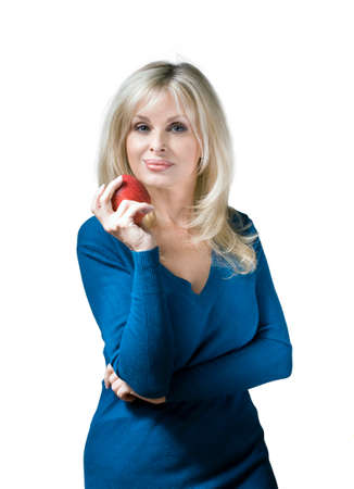 Caucasian woman holding apple against white background. Foto de archivo