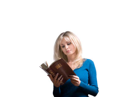 mid fifties: Woman reads a Bible indoors. Stock Photo