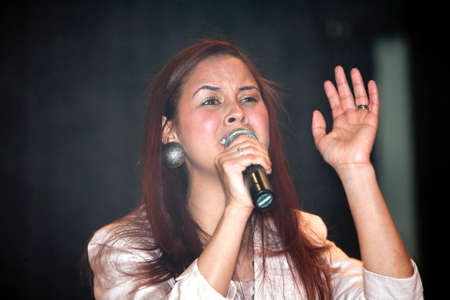 bronx county: BRONX, NEW YORK - MARCH 17: Woman performs during a Christian concert for Realizing Possibilities ministry.  Taken March 17, 2012, in  New York.