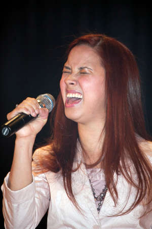 march 17: BRONX, NEW YORK - MARCH 17: Female singer performs during a Christian concert for Realizing Possibilities ministry.  Taken March 17, 2012, in  New York.