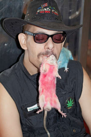 puerto rican: NEW YORK, NEW YORK - AUGUST 09: Thomas Sierra rides NYC Subway while carrying his beloved pet rats. He is of Puerto Rican ethnicity. Taken August 09, 2013, in  New York.