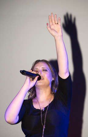 BRONX, NEW YORK - SEPTEMBER 9: Female singer Christine D Clario performs during a Christian concert for Realizing Possibilities ministry.  Taken September 9, 2012 in  New York.