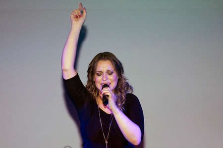 christine: BRONX, NEW YORK - SEPTEMBER 9: Female singer Christine D Clario performs during a Christian concert at a local high school for Realizing Possibilities ministry.  Taken September 9, 2012 in  New York.