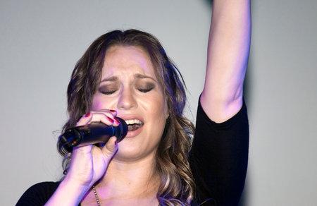 BRONX, NEW YORK - SEPTEMBER 9: Female singer Christine D Clario performs during a Christian concert for Realizing Possibilities ministry.  Taken September 9, 2012 in  New York.