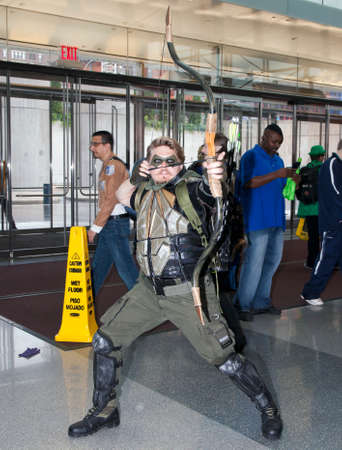 outsiders: NEW YORK, NEW YORK - OCTOBER 9: Man wearing Green Arrow costume at NY Comic Con at Jacob K. Javits convention center.  Taken October 9, 2016 in  New  York. Editorial