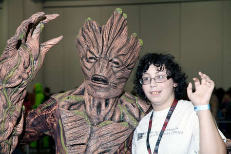 NEW YORK, NEW YORK - OCTOBER 9: Person wearing Groot costume with boy at NY Comic Con at Jacob K. Javits convention center.  Taken October 9, 2016 in  New  York. Editorial