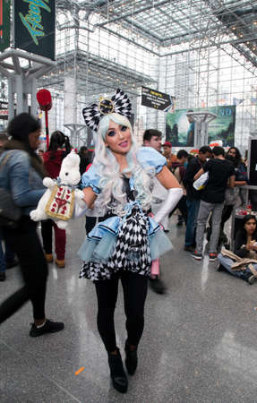 NEW YORK, NEW YORK - OCTOBER 9: Woman wearing Alice in Wonderland costume at NY Comic Con at Jacob K. Javits convention center.  Taken October 9, 2016 in  New  York.