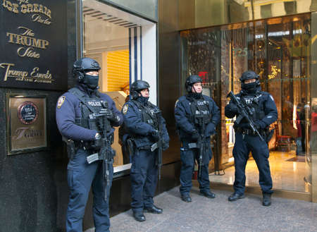 DECEMBER 19 - NEW YORK, NEW YORK: Police officers stand guard in front of Trump Tower on 56th street and 5th avenue. Taken December 19, 2016 in NYC. Editorial