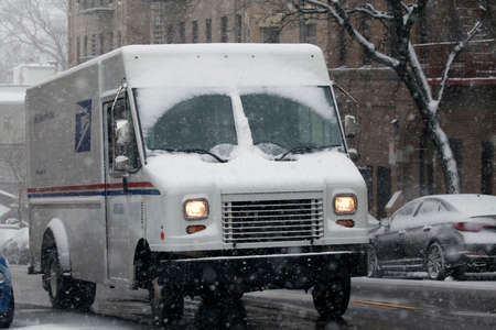 BRONX, NEW YORK -JANUARY 7: United States Postal Service truck in snow storm.  Taken January 7, 2017 in New York.