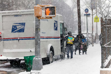mail man: BRONX, NEW YORK -JANUARY 7: Mail man delivers mail in snow storm.  Taken January 7, 2017 in New York.