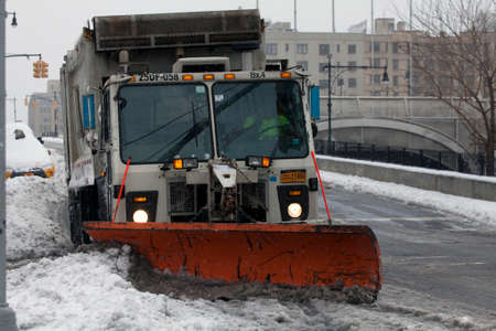 cleaning service: BRONX, NEW YORK - MARCH 14:  Sanitation truck plowing snow in the Bronx.  Taken March 14, 2017 in New York. Editorial