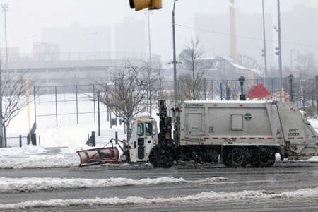 bronx county: BRONX, NEW YORK - MARCH 14:  Sanitation truck plowing snow in the Bronx.  Taken March 14, 2017 in New York. Editorial