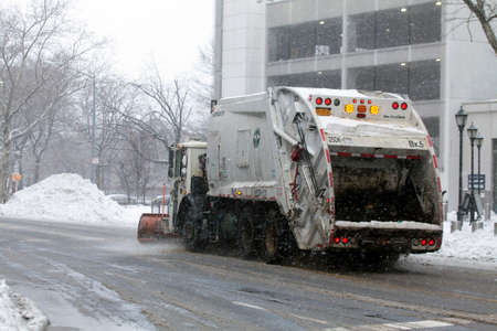 cleaning service: BRONX, NEW YORK - MARCH 14:  Sanitation trucks plowing snow in the Bronx.  Taken March 14, 2017 in New York. Editorial