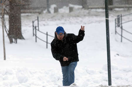 bronx county: BRONX, NEW YORK - MARCH 14:  Man walks during snow storm.  Taken March 14, 2017 in New York.