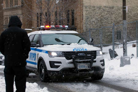 BRONX, NEW YORK - MARCH 14: Police vehicle patrols community during snow storm.  Taken March 14, 2017 in New York.