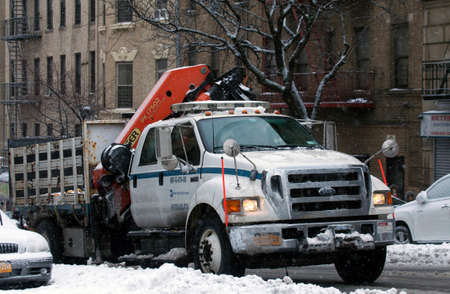 BRONX, NEW YORK - MARCH 14: Department of Transit truck with mounted Palfinger knuckle boom crane during snow storm.  Taken March 14, 2017 in New York. Editorial