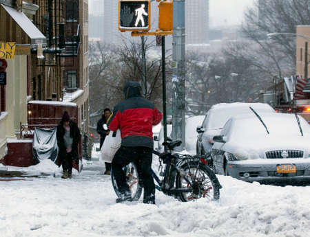 bronx county: BRONX, NEW YORK - MARCH 14:  People walk along street during snow storm.  Taken March 14, 2017 in New York.