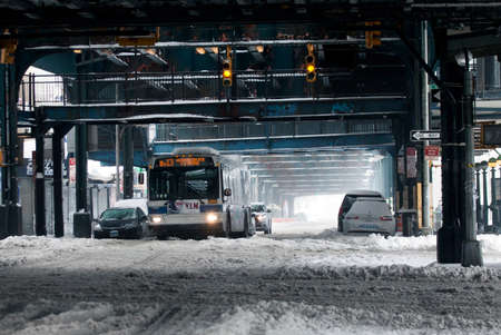 BRONX, NEW YORK - MARCH 14:  MTA bus rides during snow storm.  Taken March 14, 2017 in New York.