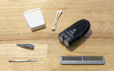 comb: Several grooming items on a wooden table